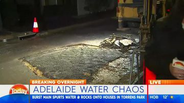 Burst water main sends debris flying into air