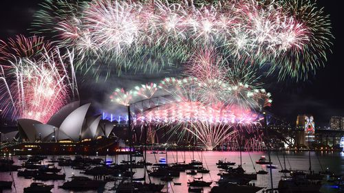 A file photo shows fireworks light up the sky over Sydney's Opera House and Harbour Bridge on January 1, 2016. (AFP)