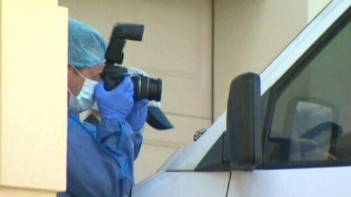 Forensic officers investigated the home where Hudson was found dead.