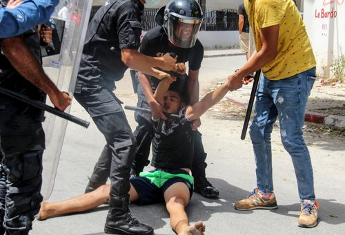 The protests were called on the 64th anniversary of Tunisia's independence by a new group called the July 25 Movement.