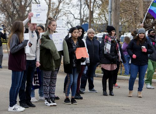 Wilder High School students protest a visit yesterday by Apple CEO Tim Cook and Ivanka Trump.