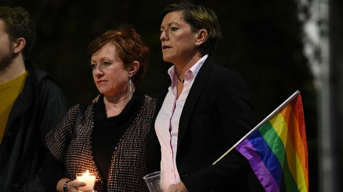 Christine Forster (right), the sister of former prime minsiter Tony Abbott, and partner Virginia Edwards attend a vigil in solidarity for the victims of the Orlando nightclub mass shooting on June 16. (AAP)