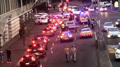The arrest shut down a Darling Harbour street.