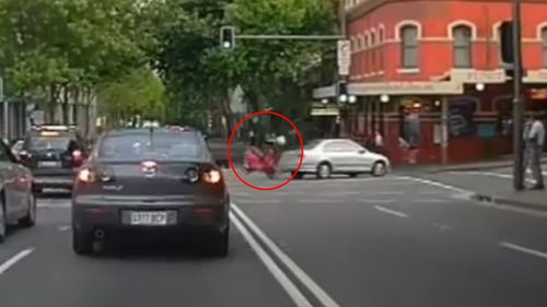 The motorcyclist hit the passenger side of the car as he travelled down Harris Street. (9NEWS)
