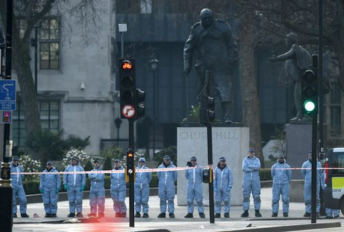 Forensic officials conduct searches in the area around the Houses of Parliament . (AAP)