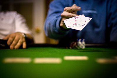 People playing card games at casinos
