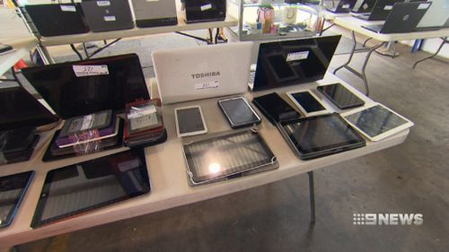 Laptops lost at Brisbane Airport will go under the hammer for charity. (9NEWS)