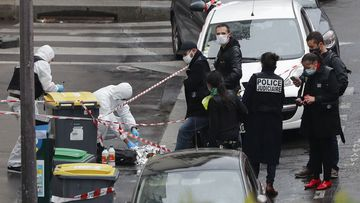 Police officers gather in the area of a knife attack near the former offices of satirical newspaper Charlie Hebdo, Friday September 25, 2020 in Paris.