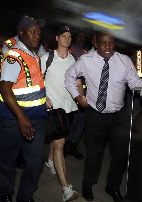 Steve Smith was booed as he was escorted through the airport to leave South Africa. (AAP)