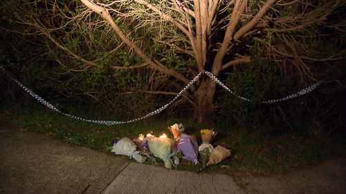 Floral tributes for the teenagers are being placed outside the home, which remains an active crime scene. Picture: 9NEWS