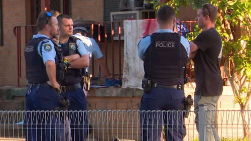 A man speaks to police after two officers were attacked.