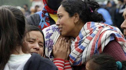 Family members of earthquake victim mourn during an early morning ceremony, a day after a massive earthquake in Kathmandu. (AP)