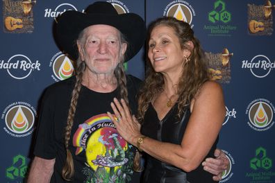 Willie Nelson and Annie D'Angelo attend Hard Rock International's Wille Nelson Artist Spotlight Benefit Concert at Hard Rock Cafe, Times Square on June 6, 2013 in New York City.