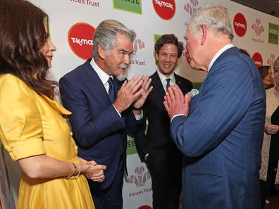 Charles greets Anna Friel, Pierce Brosnan and James Norton at the Prince's Trust Awards.