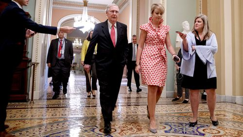 Senate Majority Leader Mitch McConnell walks to the Senate Floor in the US Capitol in Washington, DC.