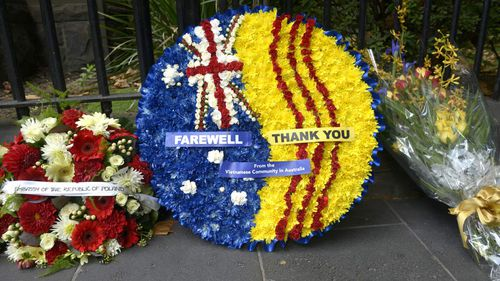 Wreaths were laid in front of Scots' Church ahead of former prime minister Malcolm Fraser's funeral in Melbourne. (AAP)