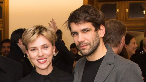Scarlett Johansson and husband Romain Dauriac cozied up at an art gallery opening in NYC.