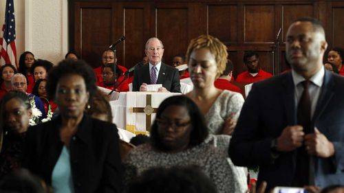 Parishioners at a church in Selma, Alabama, turn their backs to Michael Bloomberg as he addresses the congregation.