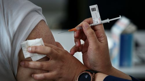 A nurse administers the Pfizer vaccine to a client at a pop-up clinic at the Lebanese Muslim Association (LMA) in Lakemba last month.
