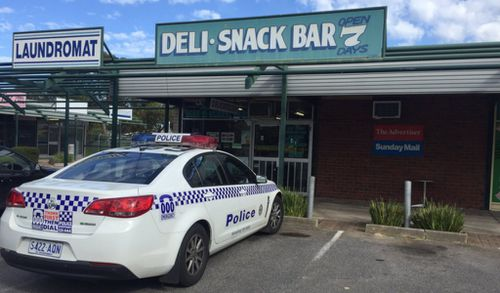 Two men armed with baseball bats on the run after deli robbery in Adelaide