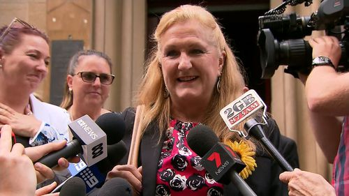 Jodie's supporters wore sunflowers to court, her favourite flower. (9NEWS)