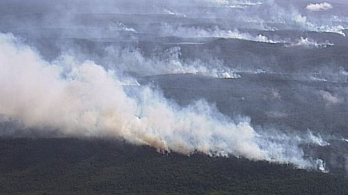 Out of control blaze burning through Happy Valley community on Fraser Island.