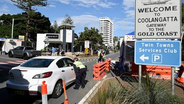 Police direct motorists at the Coolangatta border check point on the Gold Coast.