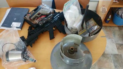 Police seized weapons, drugs and cash.