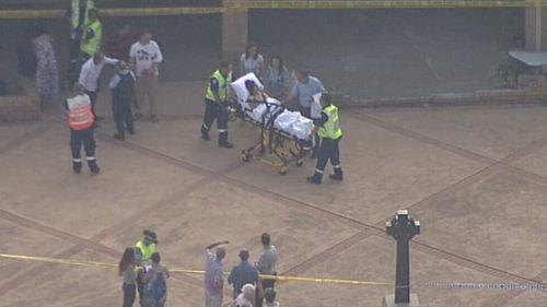Paramedics assist an injured churchgoer. (9NEWS)