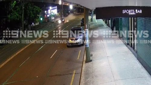The speeding car smashed through a traffic light before flipping 100 metres down the highway.
