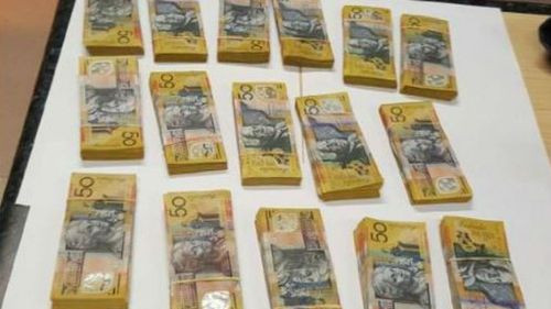 Man charged after $97k found in car following crash in central-west NSW