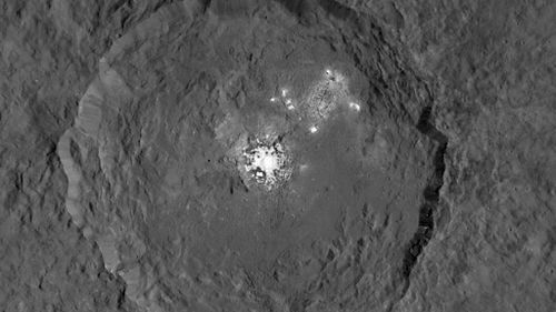 Dawn captured images of mystery white spots in the Occator crater on the dwarf planet Ceres. (Supplied)