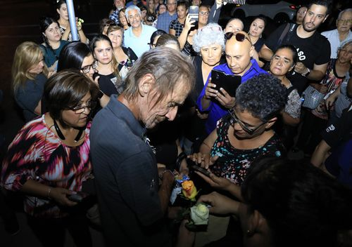 Antonio Bosco, husband of Margie Reckard who lost her life during a shooting, is offered condolences with flowers in El Paso, Texas.