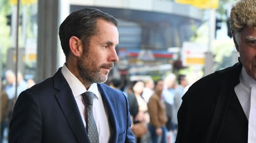 Matthew Duncan CEO of Trivett leaves with his legal team. (AAP)