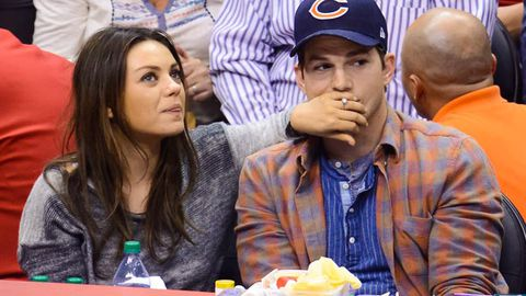 Watch: Mila Kunis and Ashton Kutcher smooch on Kiss-Cam!