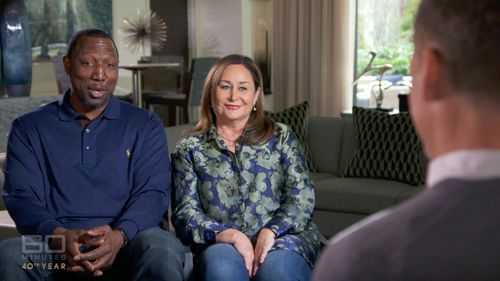 Simmons' parents Dave - a former pro basketballer - and Julie. (60 Minutes)