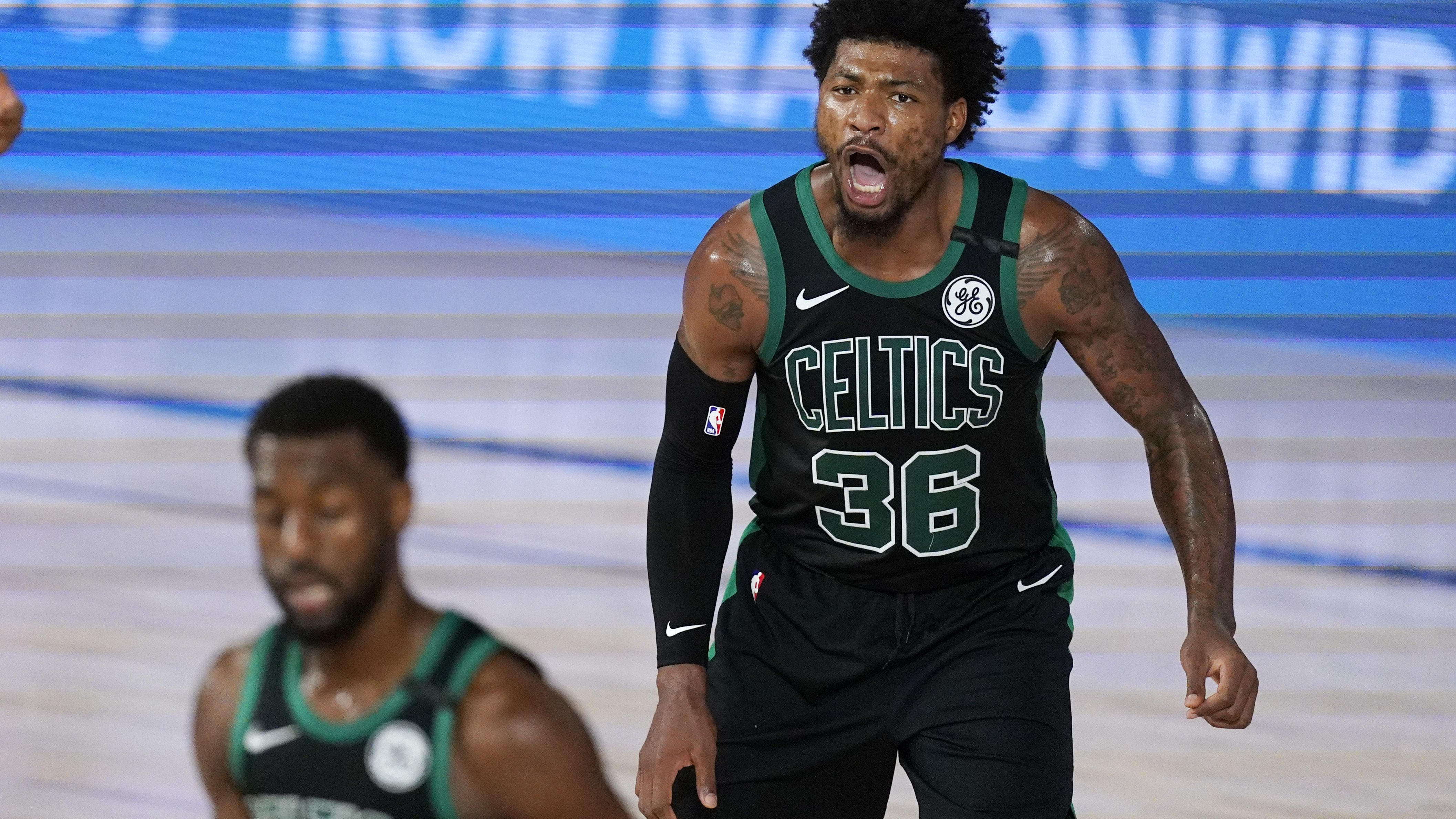 Boston Celtics guard Marcus Smart yells at his team after scoring.