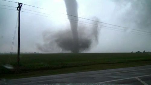 At least 21 tornadoes have been reported across the central USA.