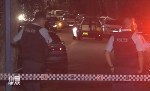 Police swarm Park Street in Campsie after a shooting.