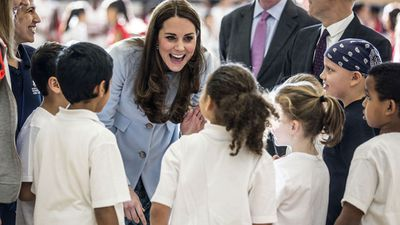 Primary school children speak to the Duchess. (AAP)
