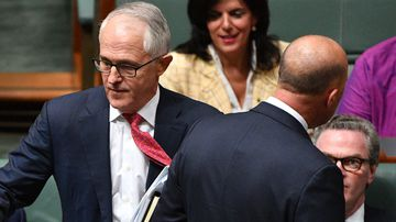 Malcolm Turnbull walking past Peter Dutton in Question Time.