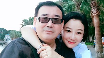 """Yang Hengjun, left, poses with a family member in Beijing. Australia's Foreign Minister Marise Payne said  her government was """"deeply disappointed"""" that the Chinese-Australian writer was placed in criminal detention in Beijing six months after he was taken into custody at a Chinese airport."""