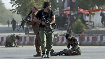 Suicide bomb blast in Kabul kills 14, narrowly avoids vice president
