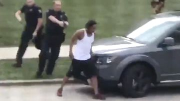 Police used a Taser and grappled with Jacob Blake before shooting him, witnesses said