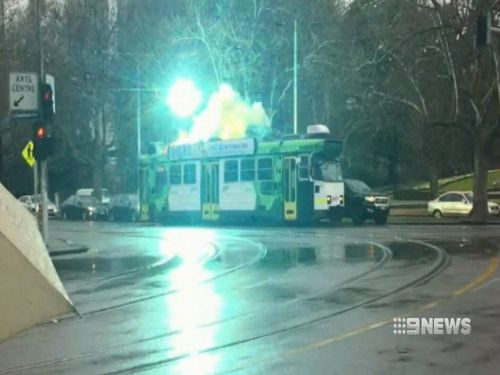 Onlookers were shocked as sparks flew out of the roof. Image: 9News