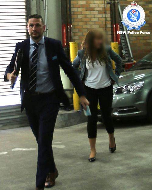 UTS Dean of Science Dianne Jolley is led away by NSW Police after her arrest on campus in November.