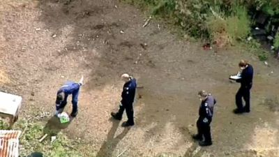 Mystery surrounds body found in shallow grave at abandoned farmhouse