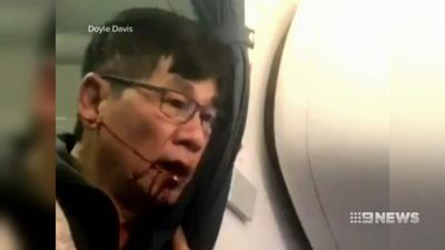 Officers who dragged doctor off US flight sacked