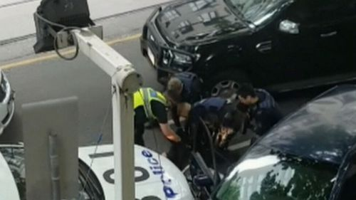 Ireland was pulled from the car by police. (9NEWS)