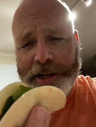 Man eating hotdog